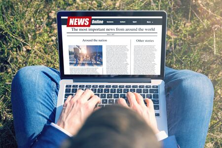 Work outside concept. Men reading news on a computer screen. Mockup website. Newspaper and portal on internet.