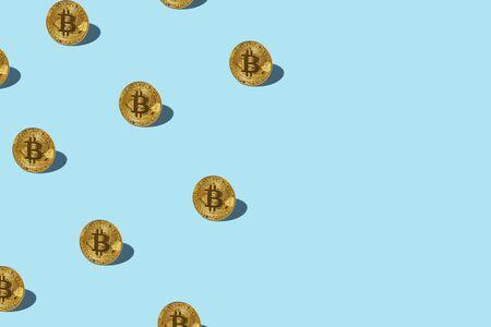 Bitcoin izometric pattern on bright light blue background. Minimal flat lay texture. Abstract trendy fresh concept.