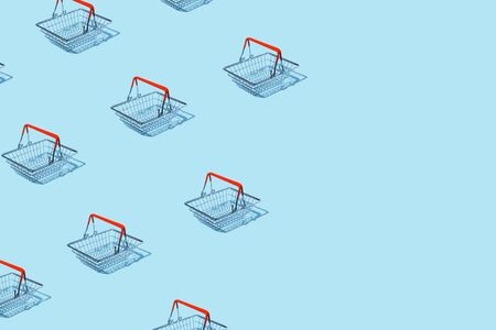 shopping cart izometric pattern on bright light blue background. Minimal flat lay texture. Abstract trendy fresh concept.