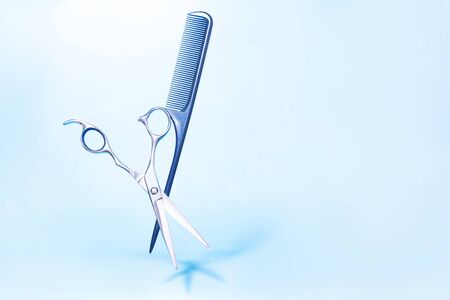 Flying hairdresser tools comb, scissors under trendy color background with copy space and soft light. Stylish Professional Barber Scissors, Hairdresser salon concept, Haircut accessories. 版權商用圖片