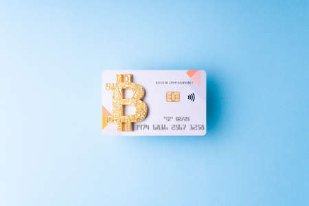 Bitcoin paying symbol. Bank bitcoin cryptocurrency card as shopping and trading concept.