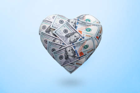 Heart shaped made with 100 dollar banknotes. Happy Valentines day symbol. Love money concept