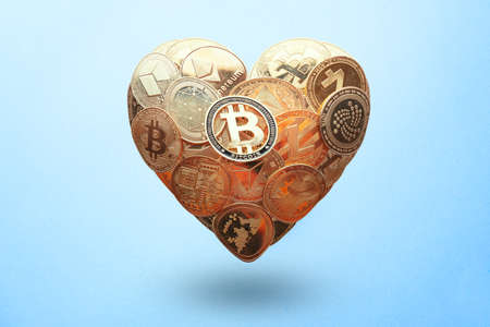Heart shaped made with cryptocurrency coins. Happy Valentines day symbol. Love bitcoin concept. Invest in bitcoin symbol. Donation, volunteer charity, CSR social responsibility idea. 版權商用圖片