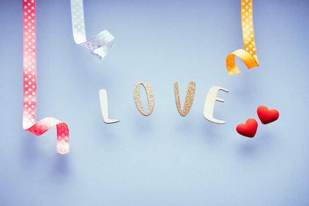 The word love on minimal pastel greeting card, frame, banner. Happy Valentines Day 版權商用圖片