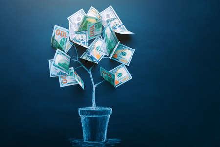 Money tree made by us dollar bills. Business, saving, growth, economic concept. Investors strategy, funding symbol. Copy space 版權商用圖片