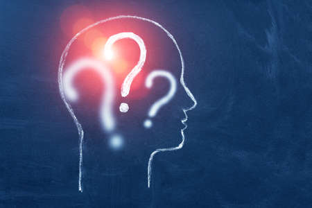 Human head with question mark symbol. Concept of education and choice, anonymous and suspect. Copy space.