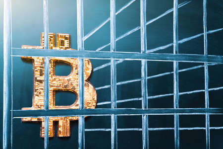 Bitcoin in prison. Concept of arrest, fraud and deception with cryptocurrency and mining. Bitcoin ban, imprison or illegal. Big troubles for bitcoin. 版權商用圖片