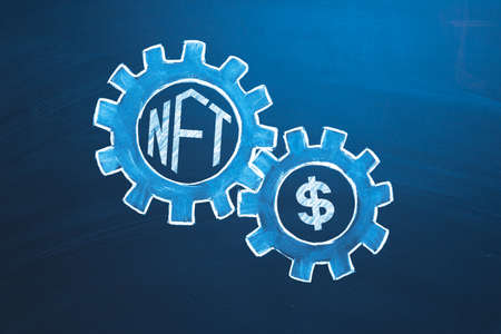 NFT non-fungible tokens concept. Logo NFT and USD in gears. Blockchain technology to create unique digital items for crypto art, crypto-collectibles and crypto-gaming 版權商用圖片