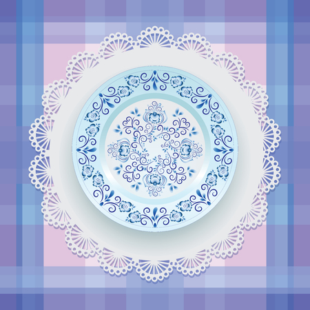 Blue floral ornament on a plate. Tableware. White porcelain with blue pattern round the border. Russian style Gzhel. Lace napkin and checkered background.