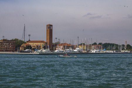 Italy. Venice lagoon on a bright summer day. Colorful houses and old tower Фото со стока