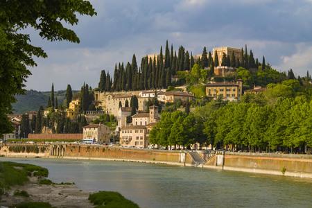 Verona, cityscape embankment view, Italy. Adige river that crosses Verona. Sunny day.