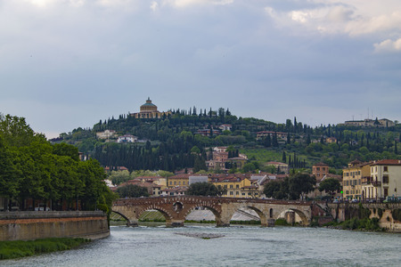 Verona Skyline with an bridge over the Adige River. Bright cityscape with a bend in the river and a bridge.