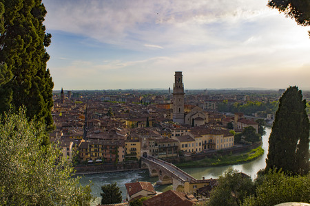 Ponte Pietra Bridge on the Adige River in Verona, Italy. Evening city. Sunset with roofs, towers, bell tower. View from above.