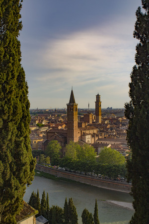 Verona Skyline with Adige River, Basilica of Santa Anastasia and Lamberti Tower, Italy. View from above. Фото со стока