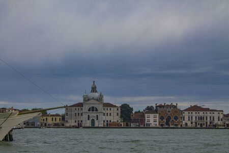 Morning in Venice. Venetian lagoon. Italy. Colorful houses on the waterfront. 스톡 콘텐츠