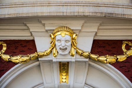 heads old building facade: Closeup of an architectural element