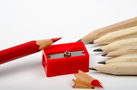 Group of wooden pencils and red sharpener on white background Stock Photo