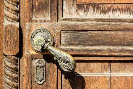 Vintage wooden door with a ornamental metal handle Stock Photo - 18104523