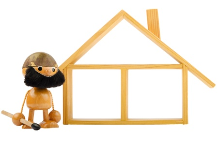 Front view of an isolated wooden house and a toy