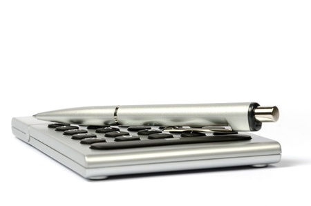 A side view of the calculator and a pen