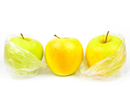 Composition of three unpeeled apples on a white background