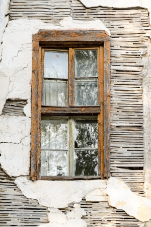 An abandoned house and a rusty window Stock Photo - 20863005