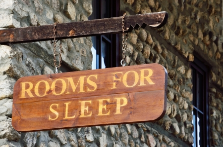 Wooden sign on the wall of the motel
