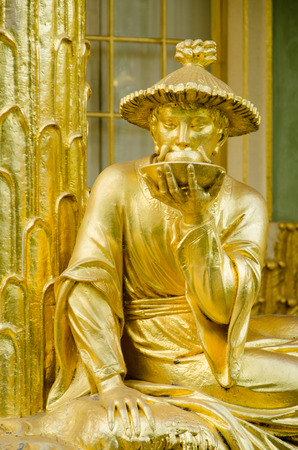 Single golden statue in front the Chinese house, part of Sanssouci park  18th century   Sanssouci is the former summer palace of Frederick the Great, King of Prussia