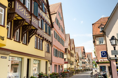 Street view of Tubingen old town  Tubingen is a traditional university town in central Baden-W�rttemberg, Germany  It is situated 30 km south of the state capital, Stuttgart, on a ridge between the Neckar and Ammer rivers