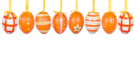 Group of hanging Easter eggs on a white background photo