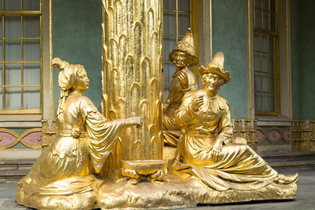 Golden statues in front the Chinese house, part of Sanssouci park  18th century   Sanssouci is the former summer palace of Frederick the Great, King of Prussia