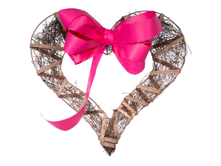 Dark wooden handmade heart and ribbon on a white background photo