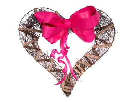 cherishing: Dark wooden handmade heart and ribbon on a white background
