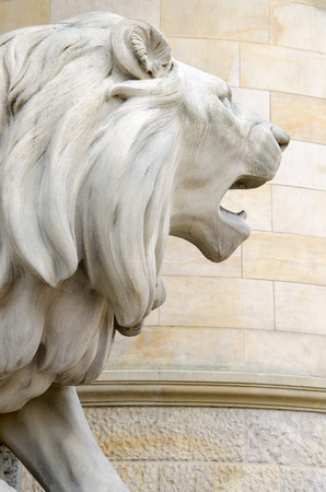 Statue of a lion, a new town hall of Hanover, Germany photo