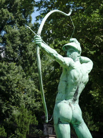 Archer statue in Sanssouci Park, Potsdam, Germany, Europe photo