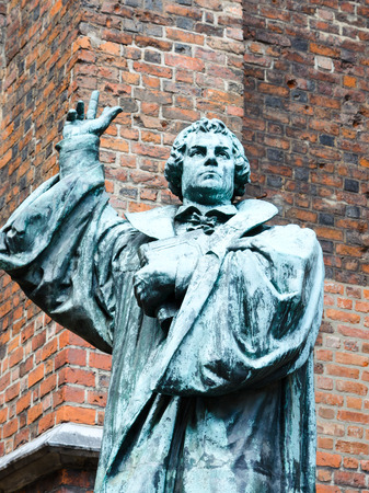 A statue of Martin Luther, beside the entrance of Marktkirche  Marketchurch , Hannover  Martin Luther was a German monk, Catholic priest and professor of theology of the 16th-century movement in Christianity known later as the Protestant Reformation