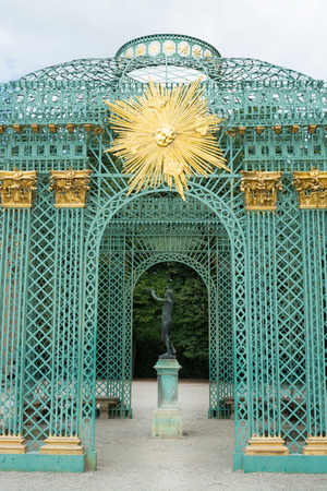 Golden star badge on the royal pavilion in the palace garden of Schloss Sanssouci in Potsdam, Germany Editorial