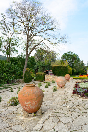 balchik: Flowers and pots in the botanical gardens, Balchik town, Bulgaria, Europe.