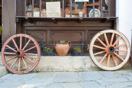 Two old wagon wheels on a street, Tryavna, Bulgaria Stock Photo