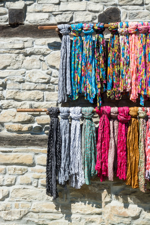 Street market of scarves and stone wall, Plovdiv, Bulgaria Stock Photo