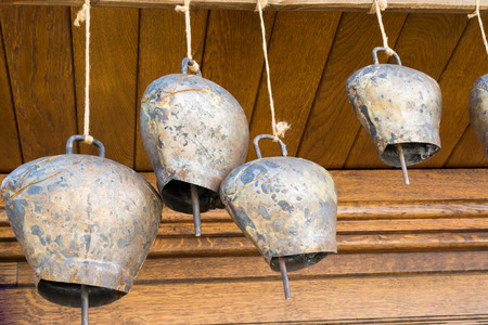 Cow-bells hanging on a wooden beam, Tryavna, Bulgaria Stock Photo
