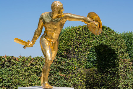 Golden sculpture at the open air theater in the royal Herrenhausen Gardens showing a Borghese gladiator, Hannover, Lower Saxony, Europe Stock Photo