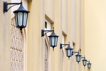 Series of lanterns on a yellow wall, Dubai, United Arab Emirates