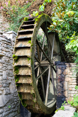 Old wooden water wheel with moss, Bulgaria