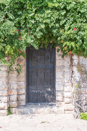 Classic wooden door on stonewall, Balchik, Bulgaria