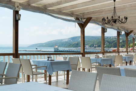 balchik: White restaurant tables and chairs, Black sea coast, Balchik, Bulgaria