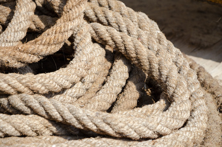 detailed shot: Texture of coarse rope lines. Detailed shot of a nautical rope. Stock Photo