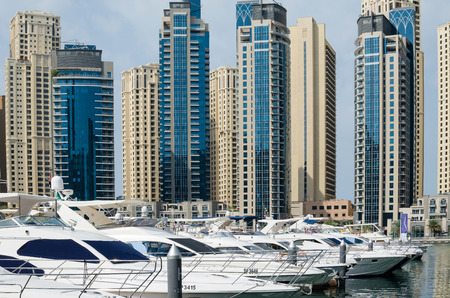 The Dubai Marina filled with luxury yachts and boats Editorial