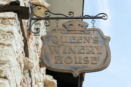 Queens winery sign on a stone wall at the botanical garden, old Balchik Palace, Bulgaria, Europe