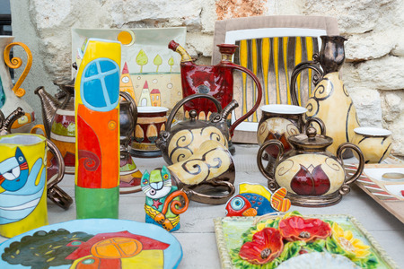 Typical colorful souvenirs in Bulgarian style at a souvenir stand in Balchik, Varna, Bulgaria.